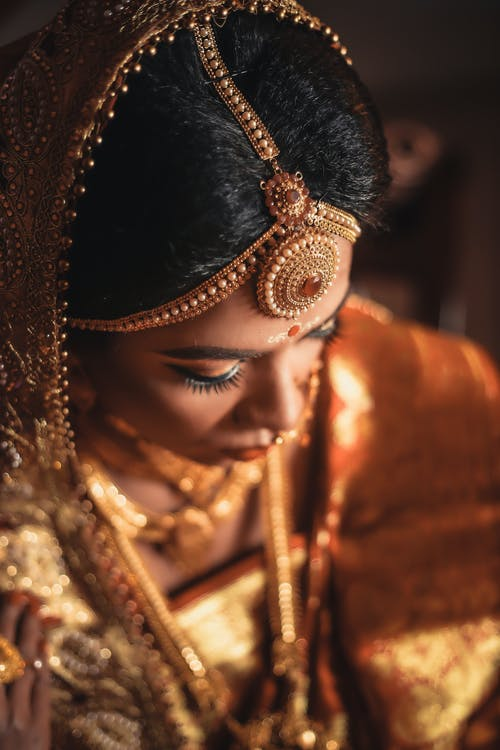 Selective Focus Photography of Woman Wearing Brown Traditional Dress