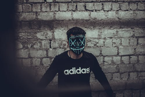 Man Wearing Black Adidas Long Sleeve Shirt And Mask