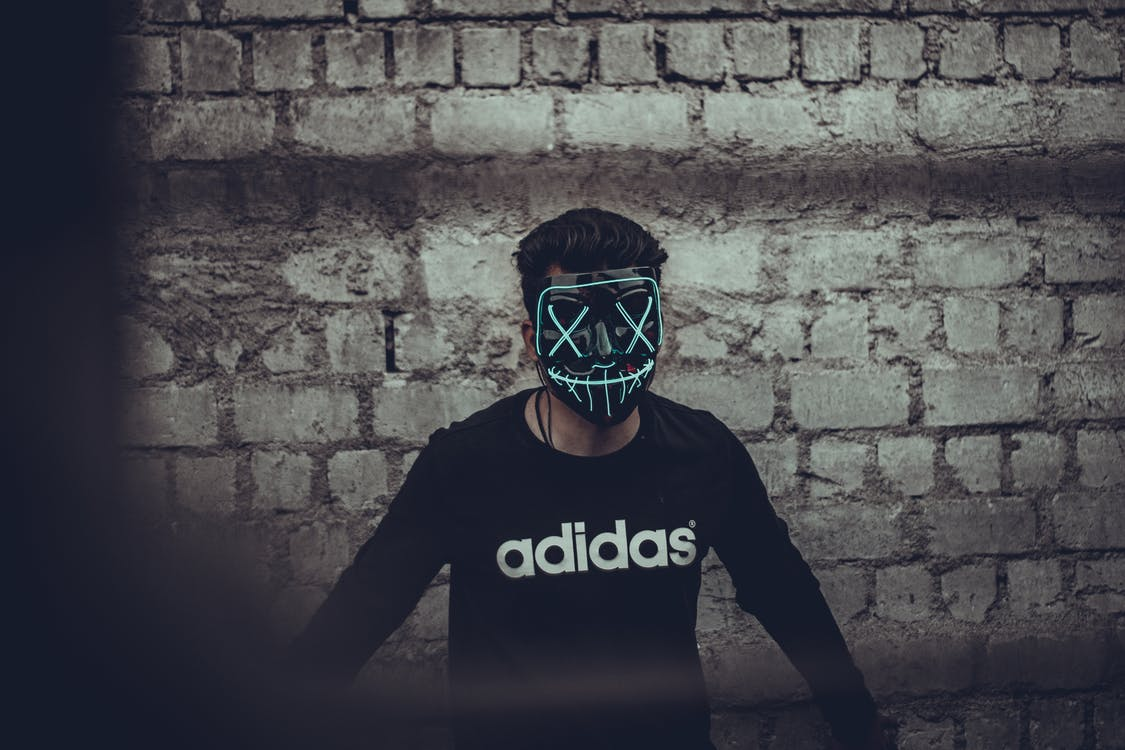 Man Wearing Black Adidas Long Sleeve Shirt And Mask