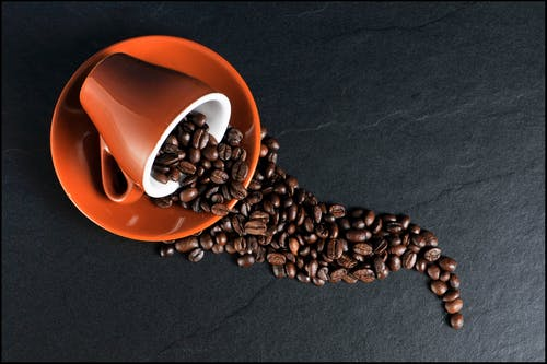 Coffee Beans; Ceramic Mug and Saucer