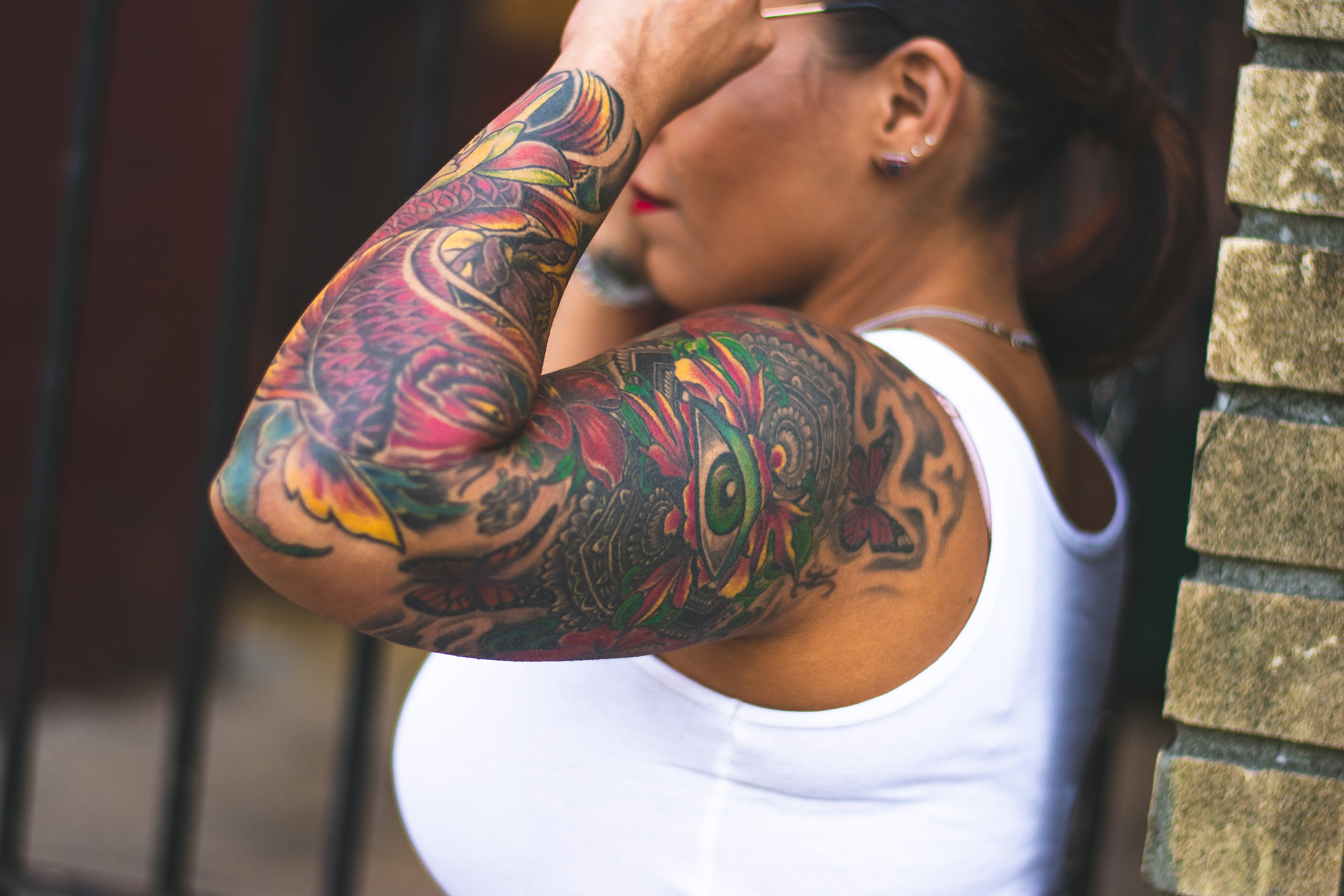 Close-Up Photo of Woman's Arm With Tattoo