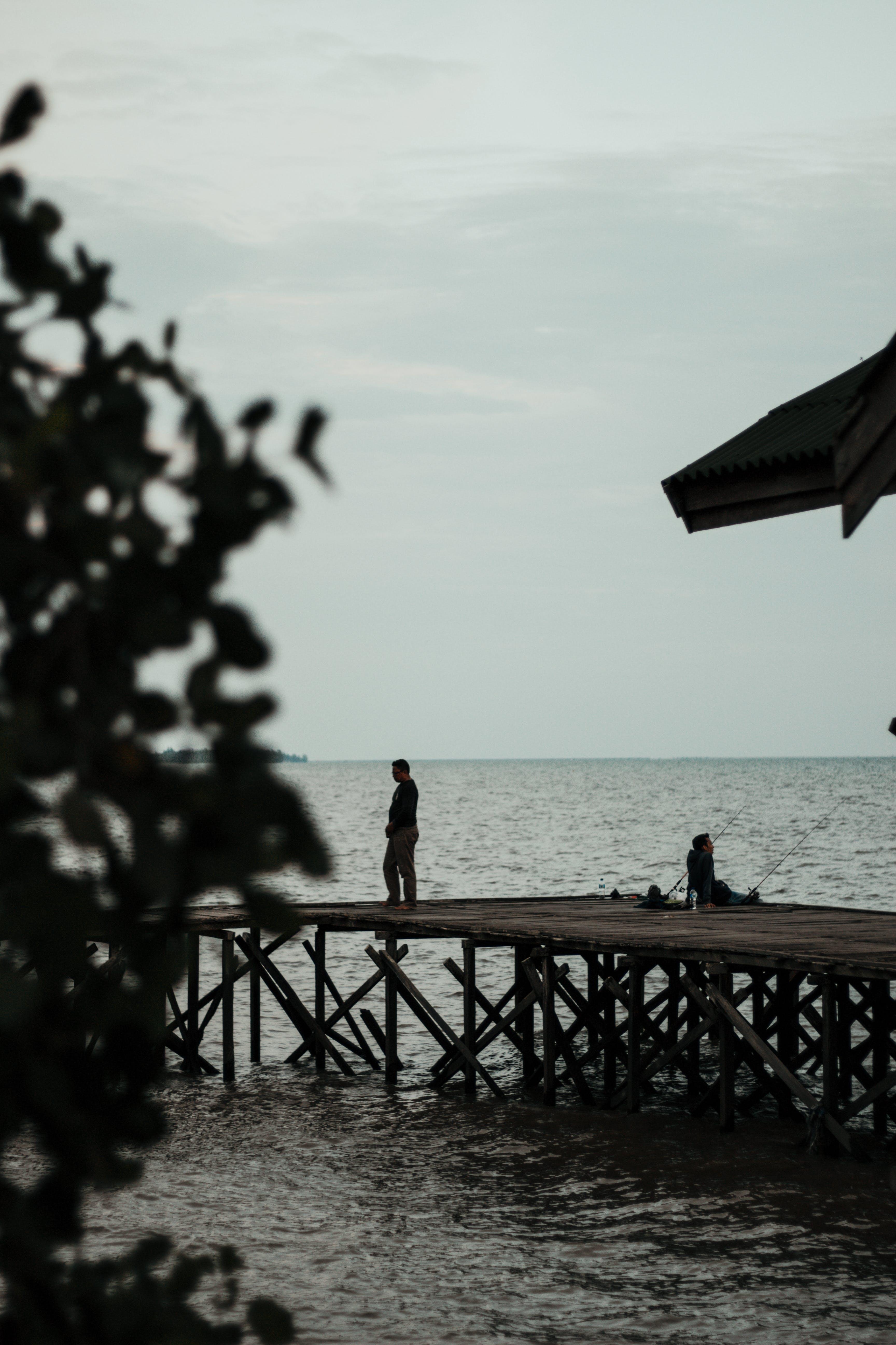 Man Standing On Boardwalk