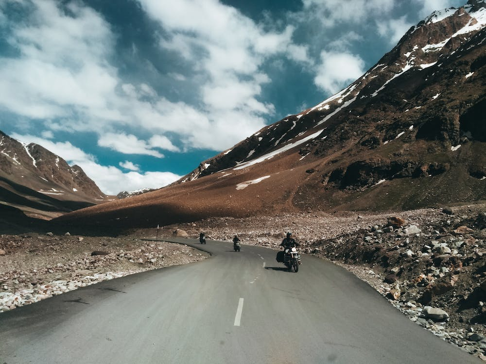 Three Tourist Motorcycles on Road