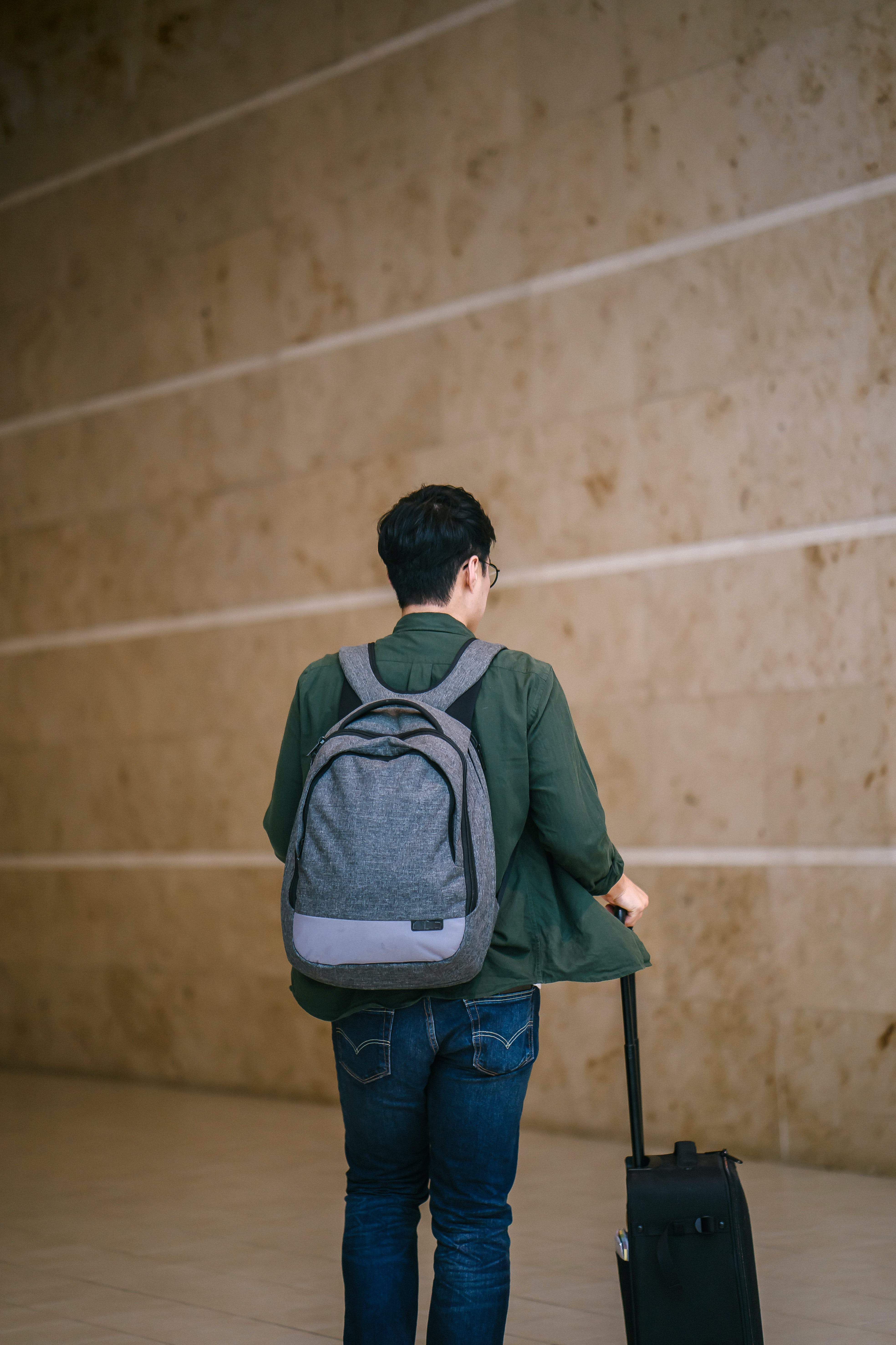 Man in Green Jacket With Backpack