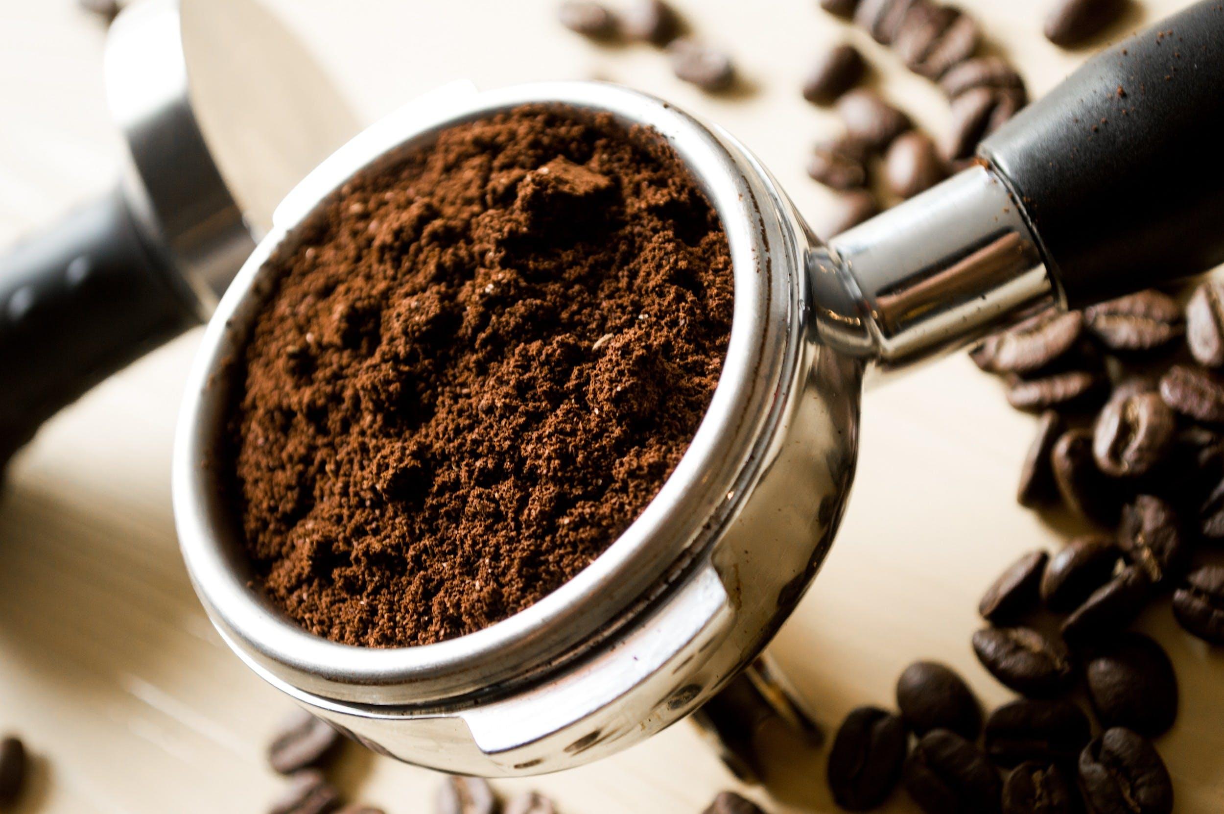 Black Coffee in Stainless Steel Scoop