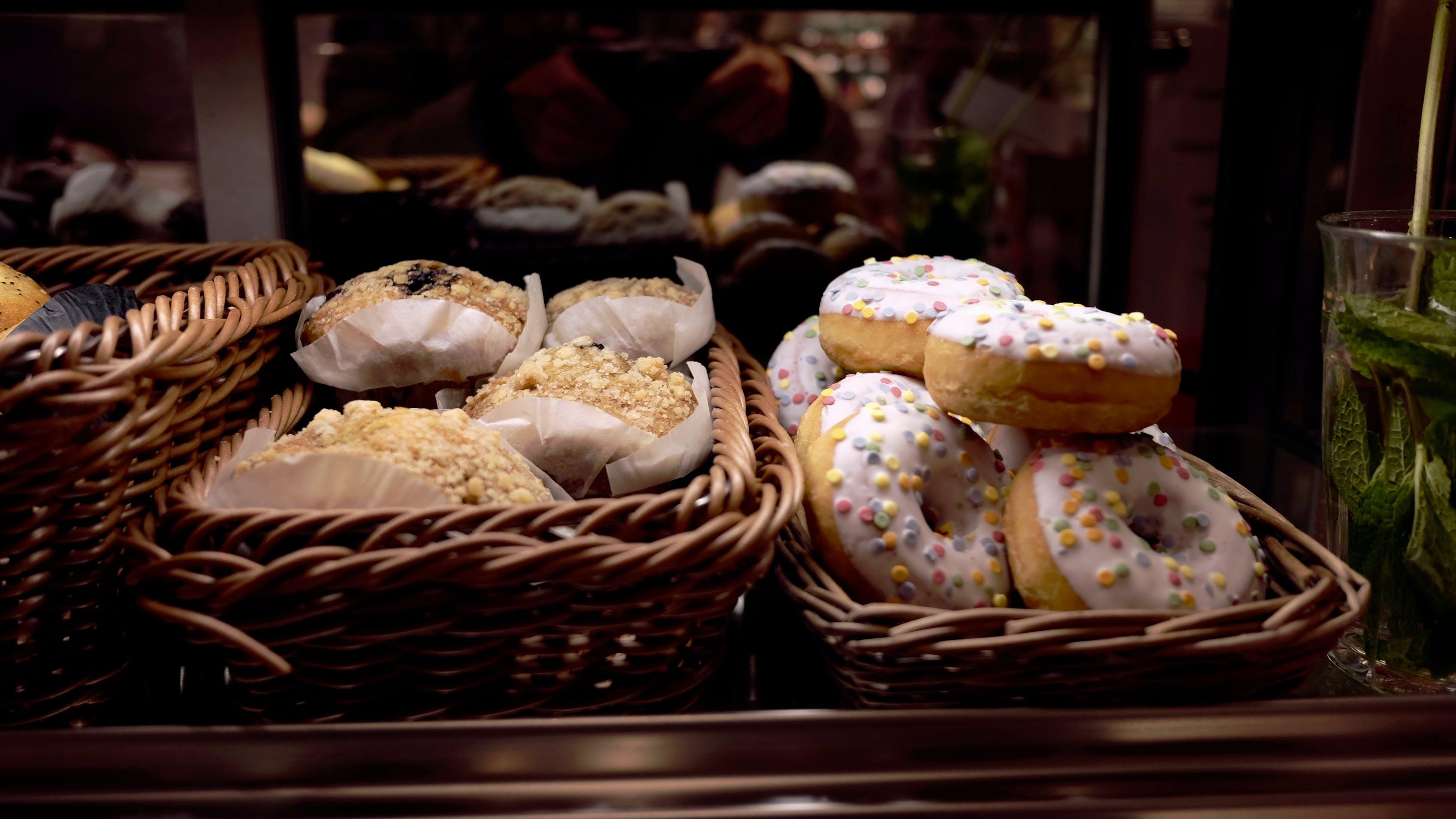 White Topped Doughnut Beside Peanut Cupcake