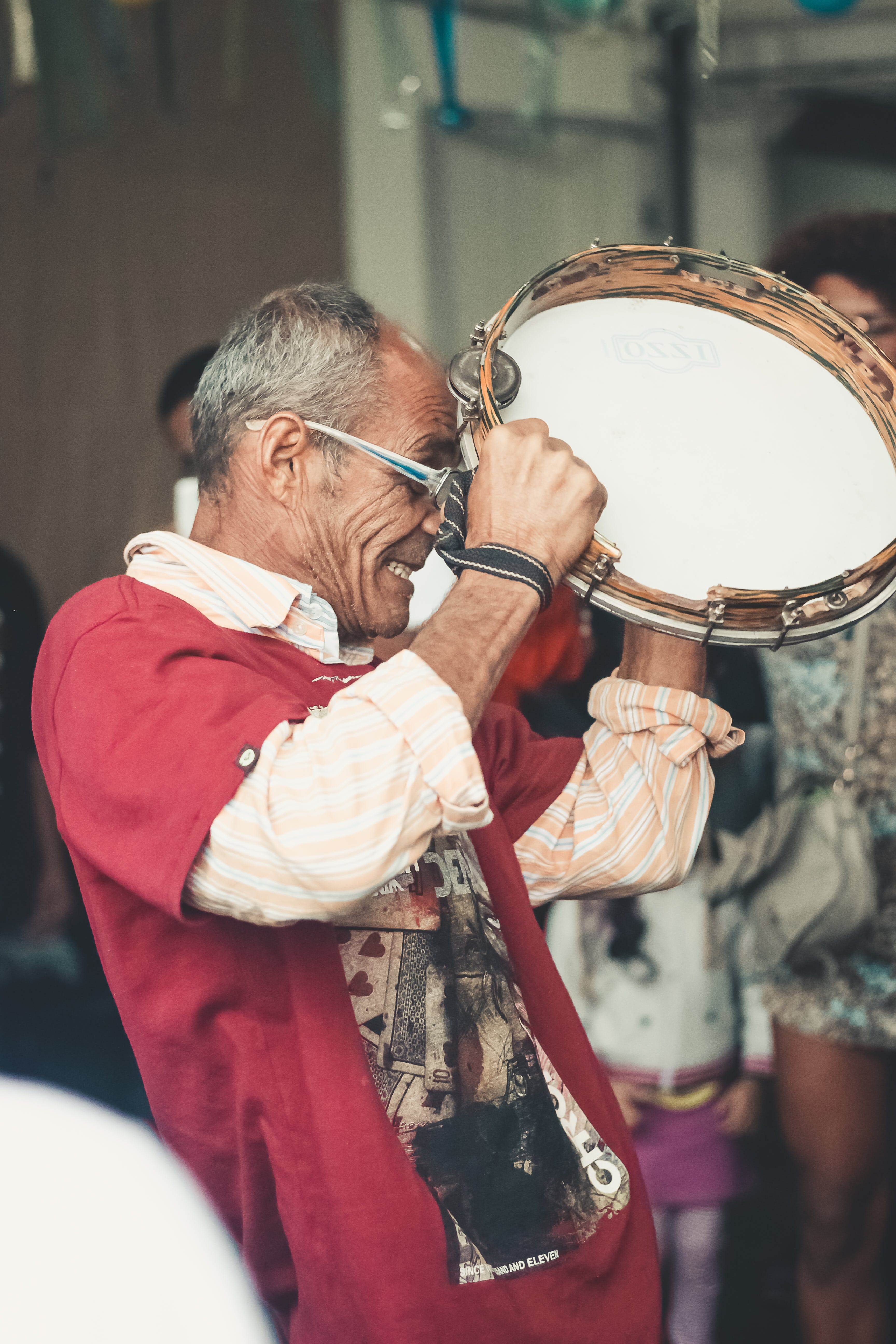 Man Playing Tambourine