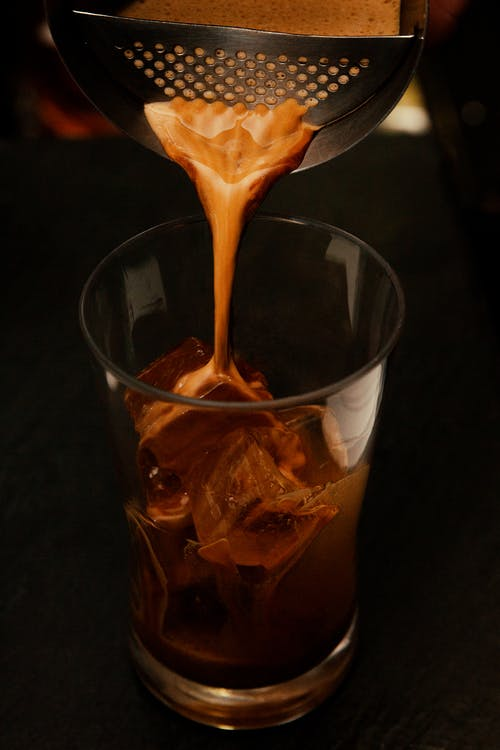 Clear Drinking Glass Filled With Coffee