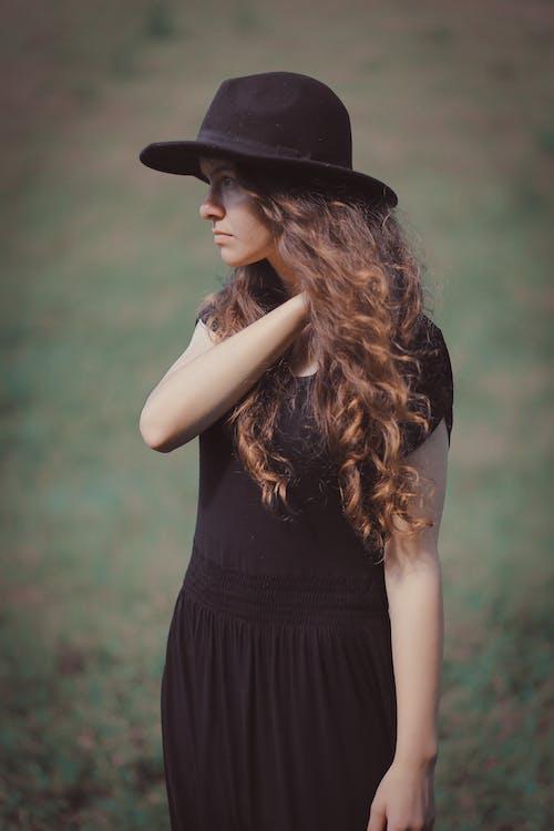 Woman Wearing Black Short-sleeved Dress and Black Sunhat