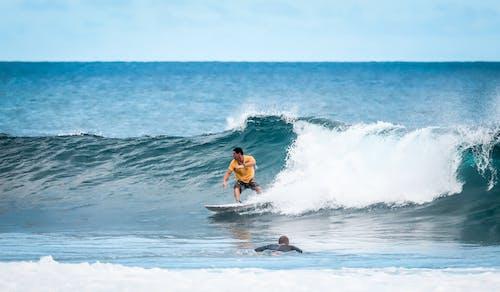 Fotos de stock gratuitas de dice adiós, hacer surf, olas rompiendo, superficie