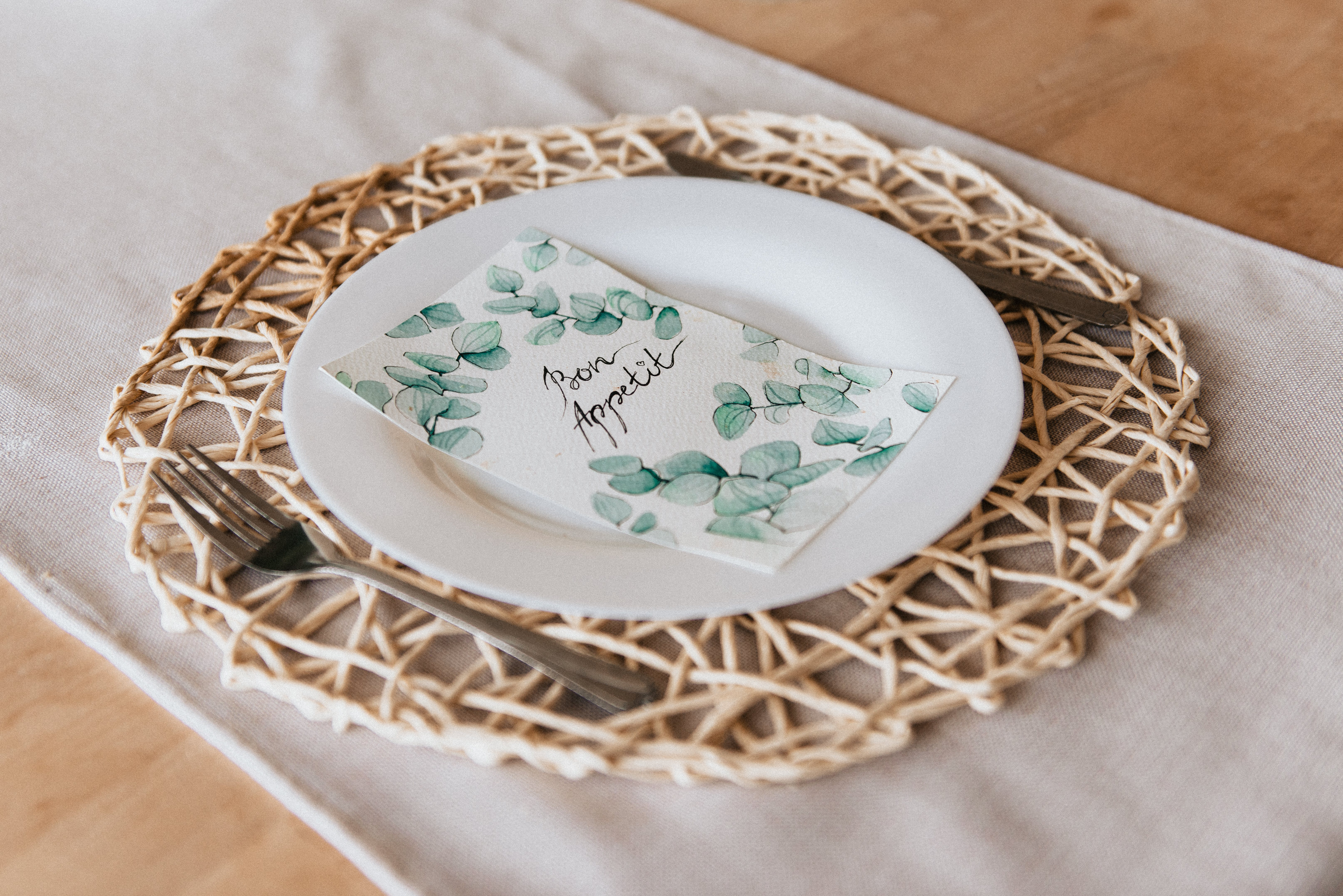Round White Ceramic Decorative Plate on Brown Mat