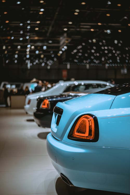 Teal, Black, and White Luxury Cars