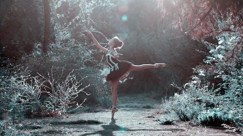 Woman Dancing Between Plants