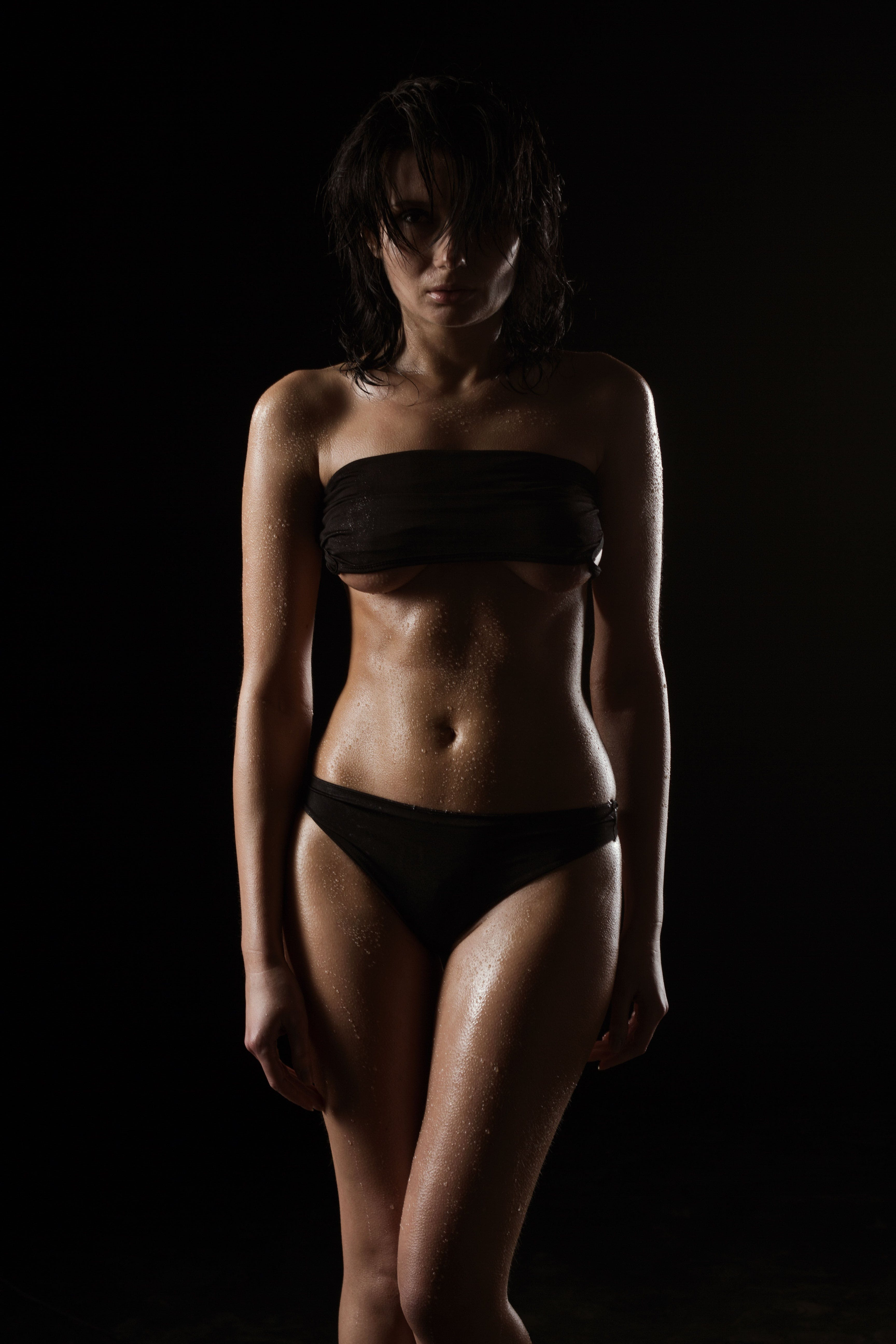 Woman Wearing Black Tube Top and Black Panty in a Dim Lighted Scenario