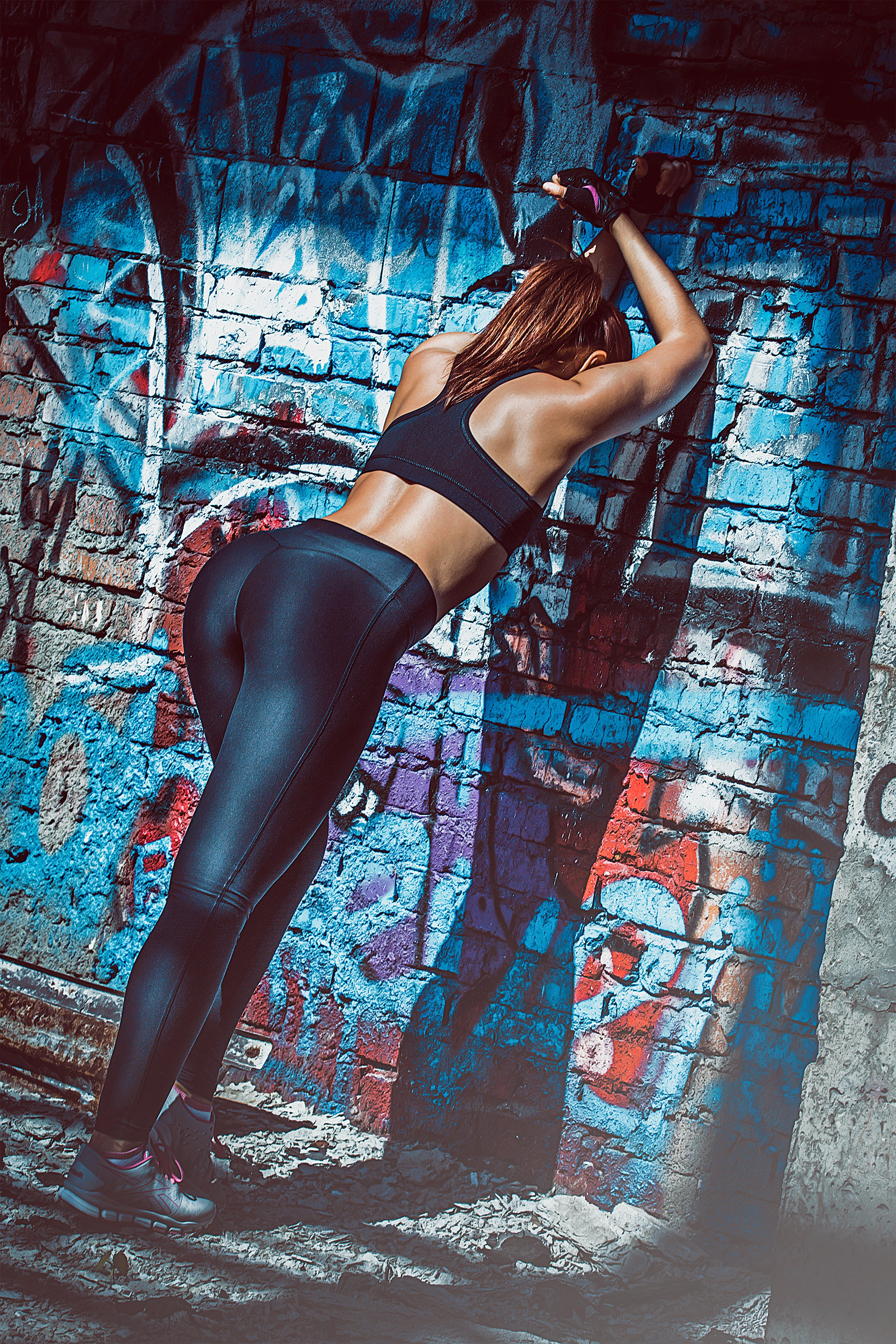 Person Leaning on the Wall Wearing Sports Bra and Leggings
