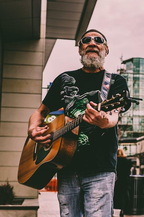 Man Playing Guitar on Street