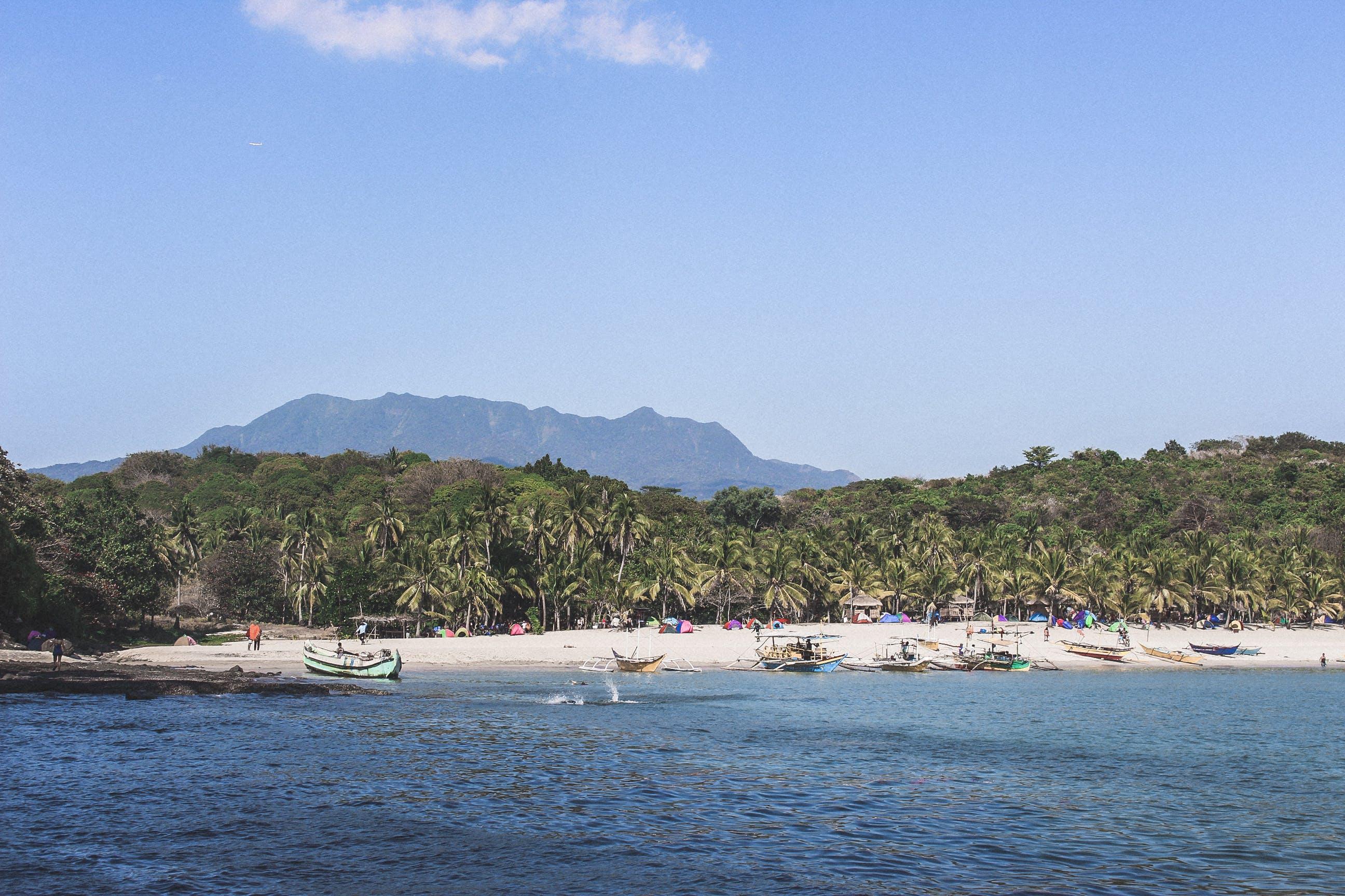 Foto d'estoc gratuïta de barca de pesca, barques, davant de la platja, Filipines