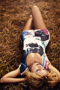 Woman N Blue White and Black Bodycon Dress Lying on Hay