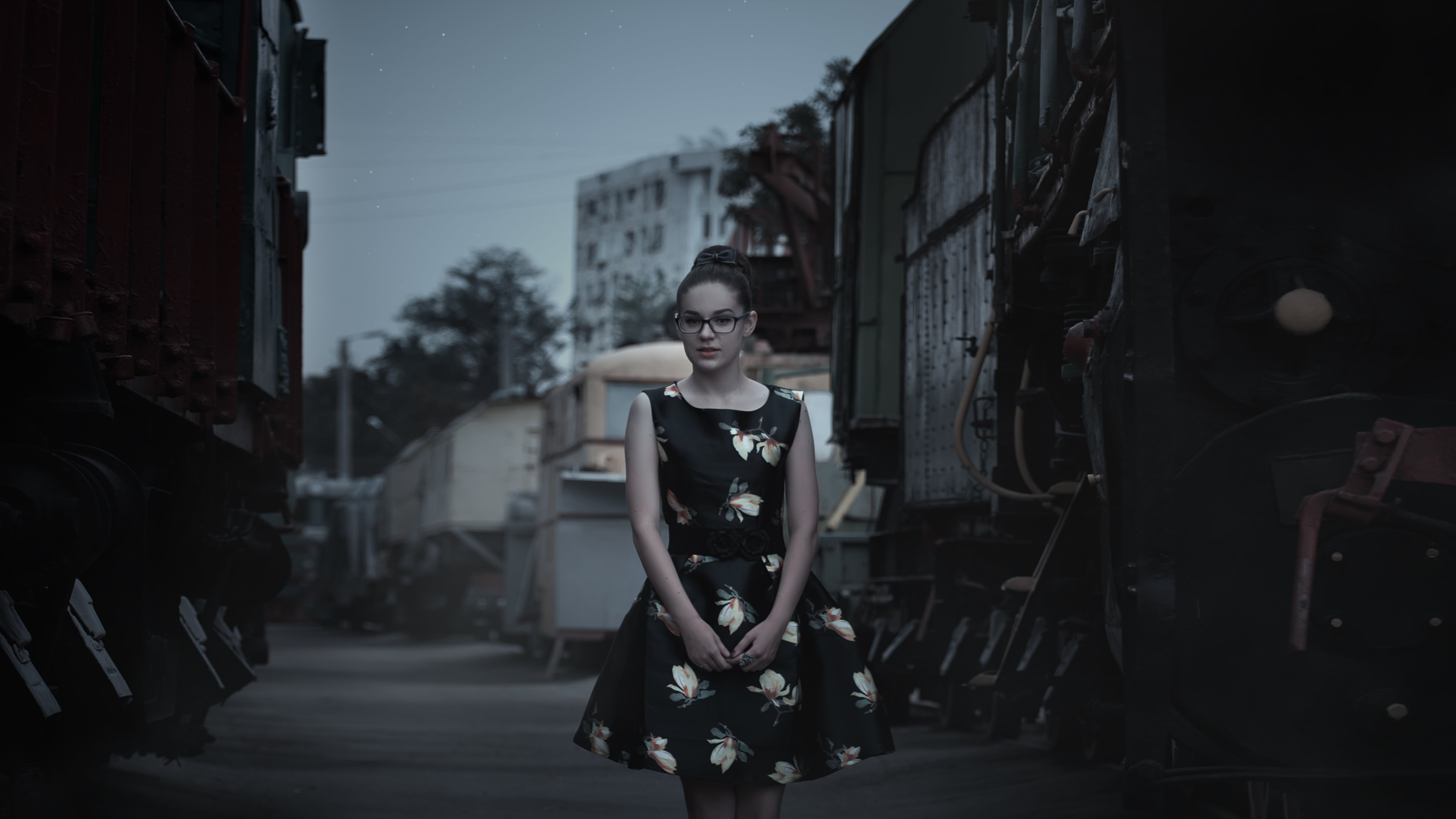 Woman Standing on Road Near Building during Blue Hour