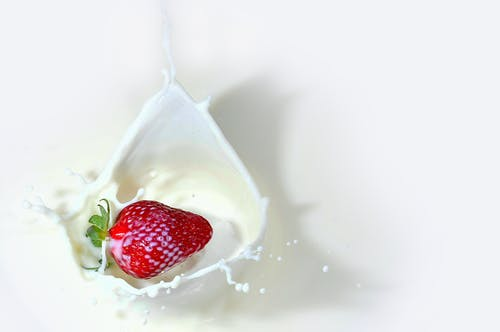 Strawberry Fruit dropped in milk
