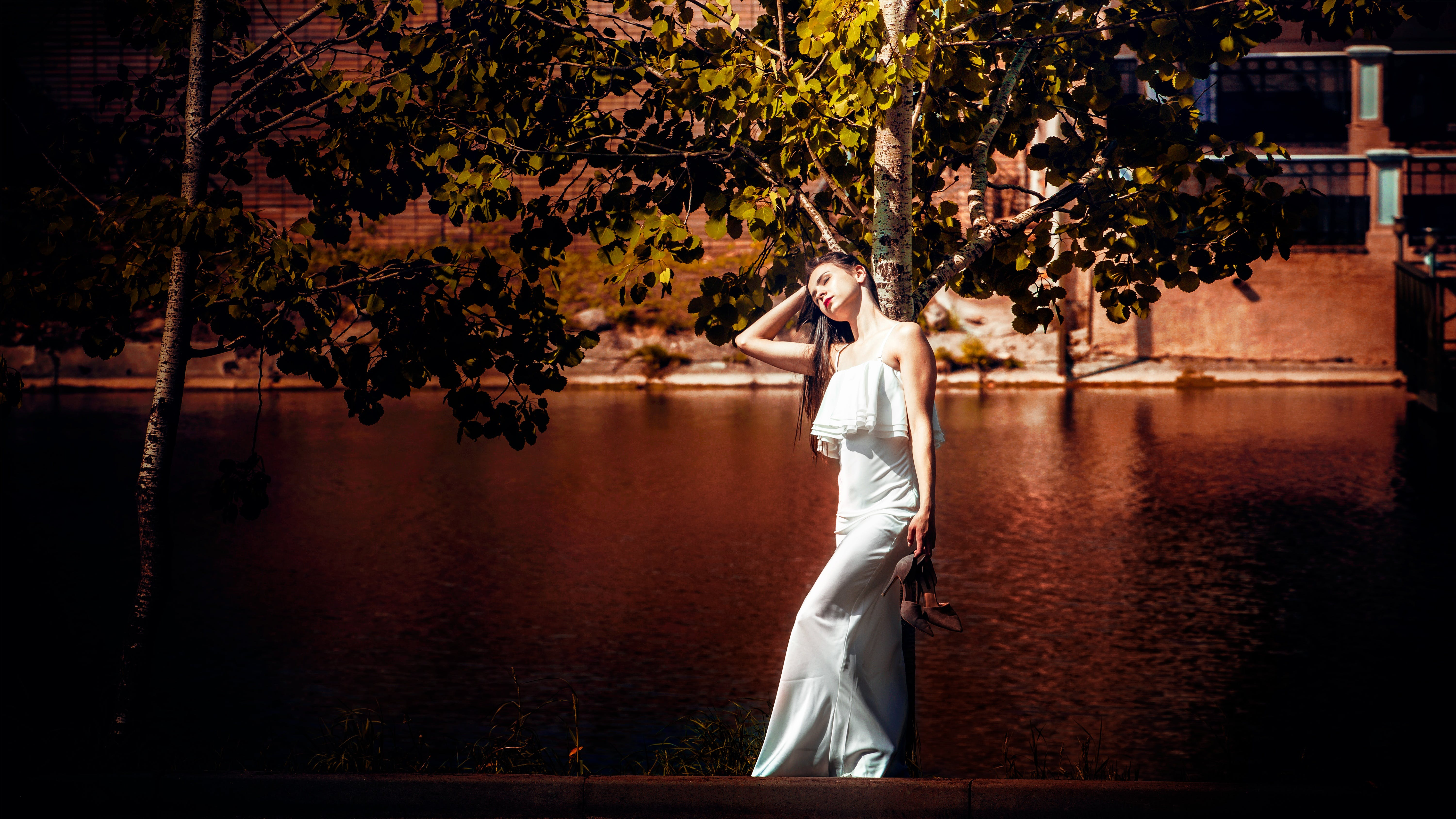 Woman Stand Beside Tree and Body of Water