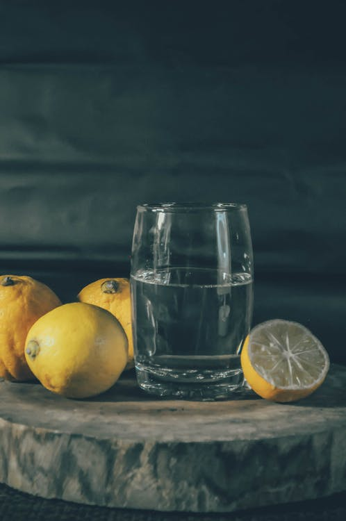 Photo of  Drinking Glass Beside Lemons