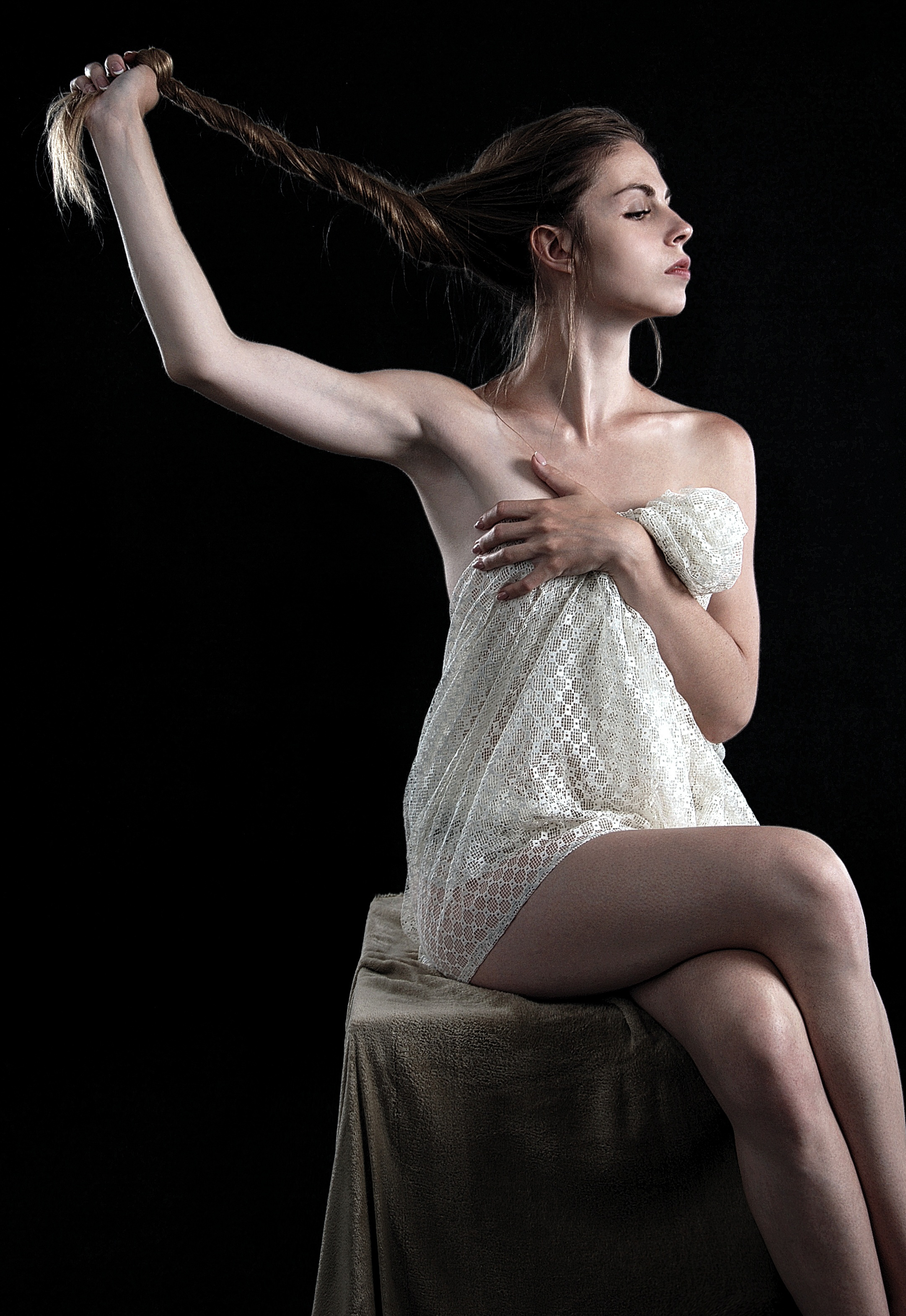 Woman Sitting on Stool While Holding Her Hair