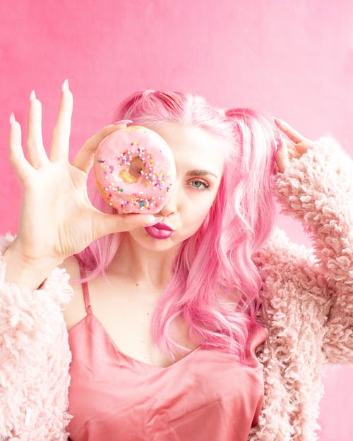 Woman Covered Her Right Face With Pink Doughnut