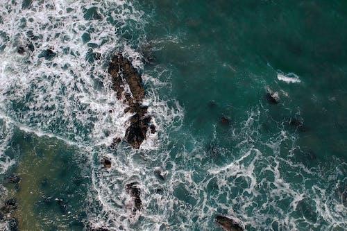 Бесплатное стоковое фото с бирюзовый, вода, волны, всплеск