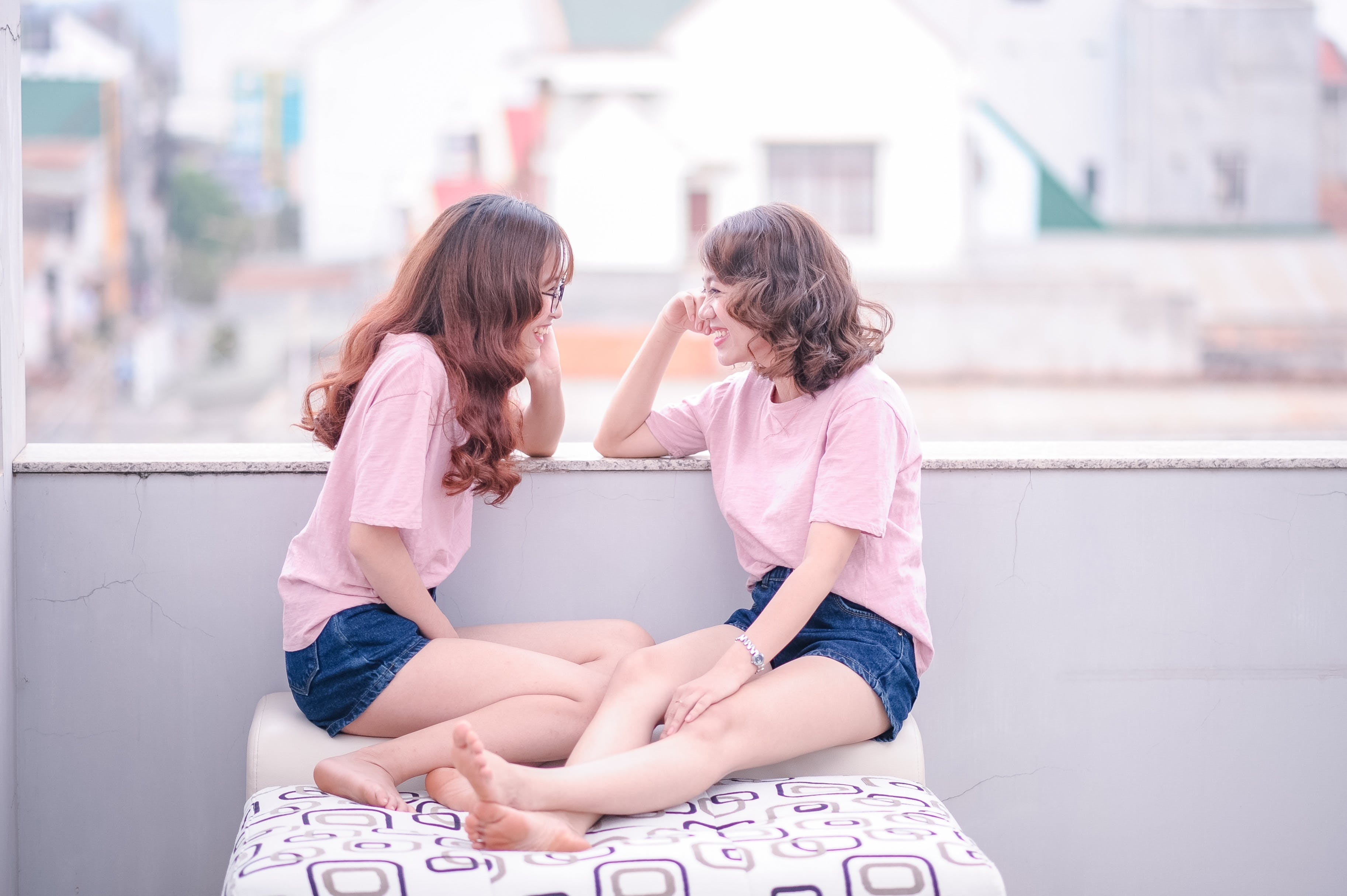 Two Women Wearing Pink T-shirts