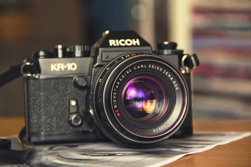 Selective Focus Photography of Black Ricoh Kir-10 Camera