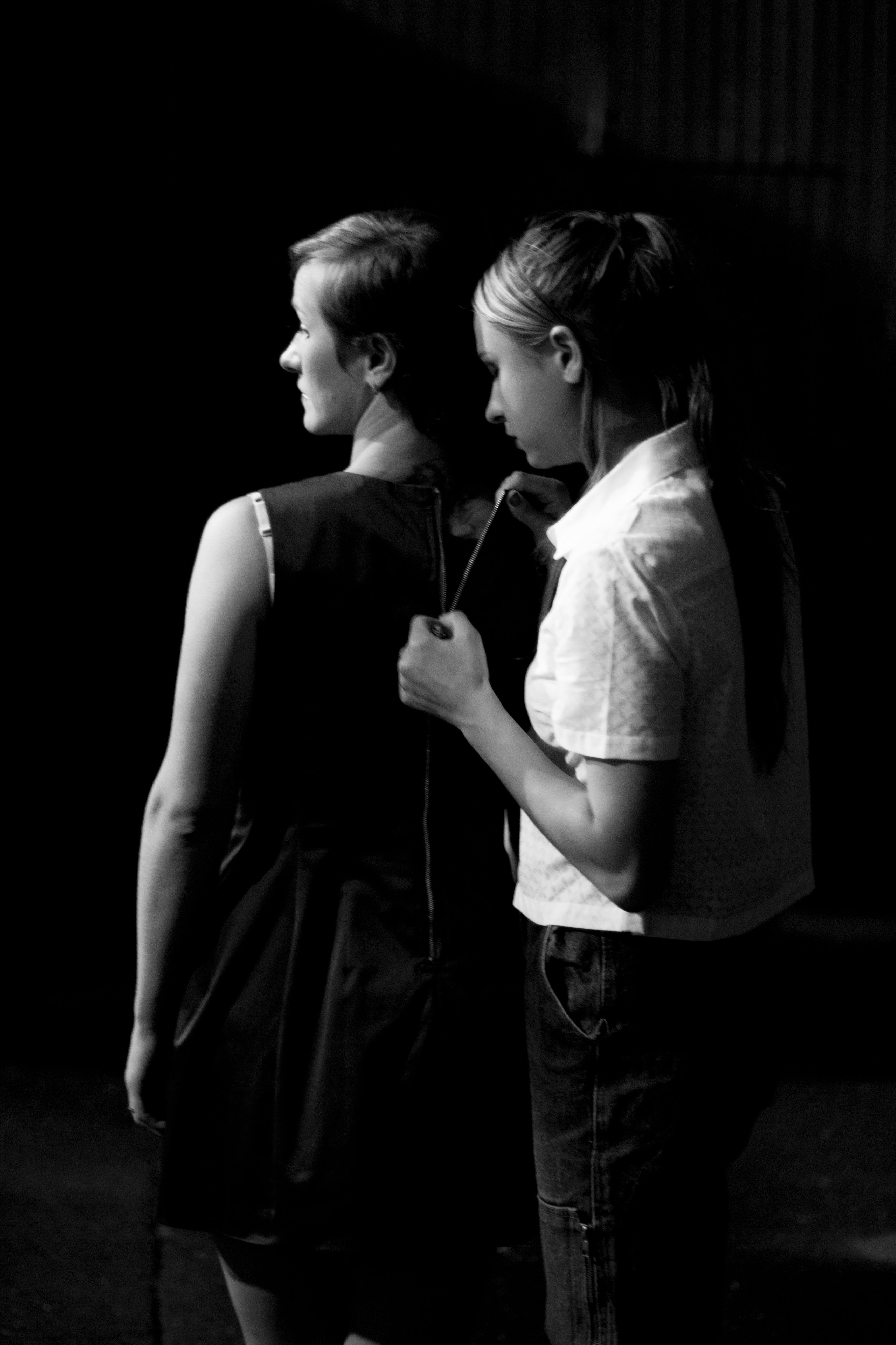 Silhouette of Two Girls Standing