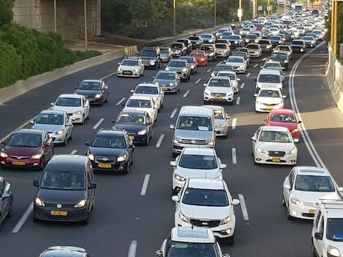 Gratis stockfoto met auto's, straat, verkeer