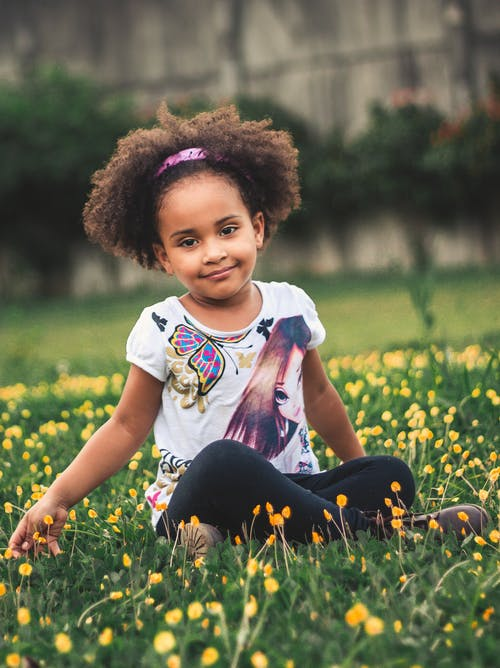Photo of Girl Sitting On Flower Field