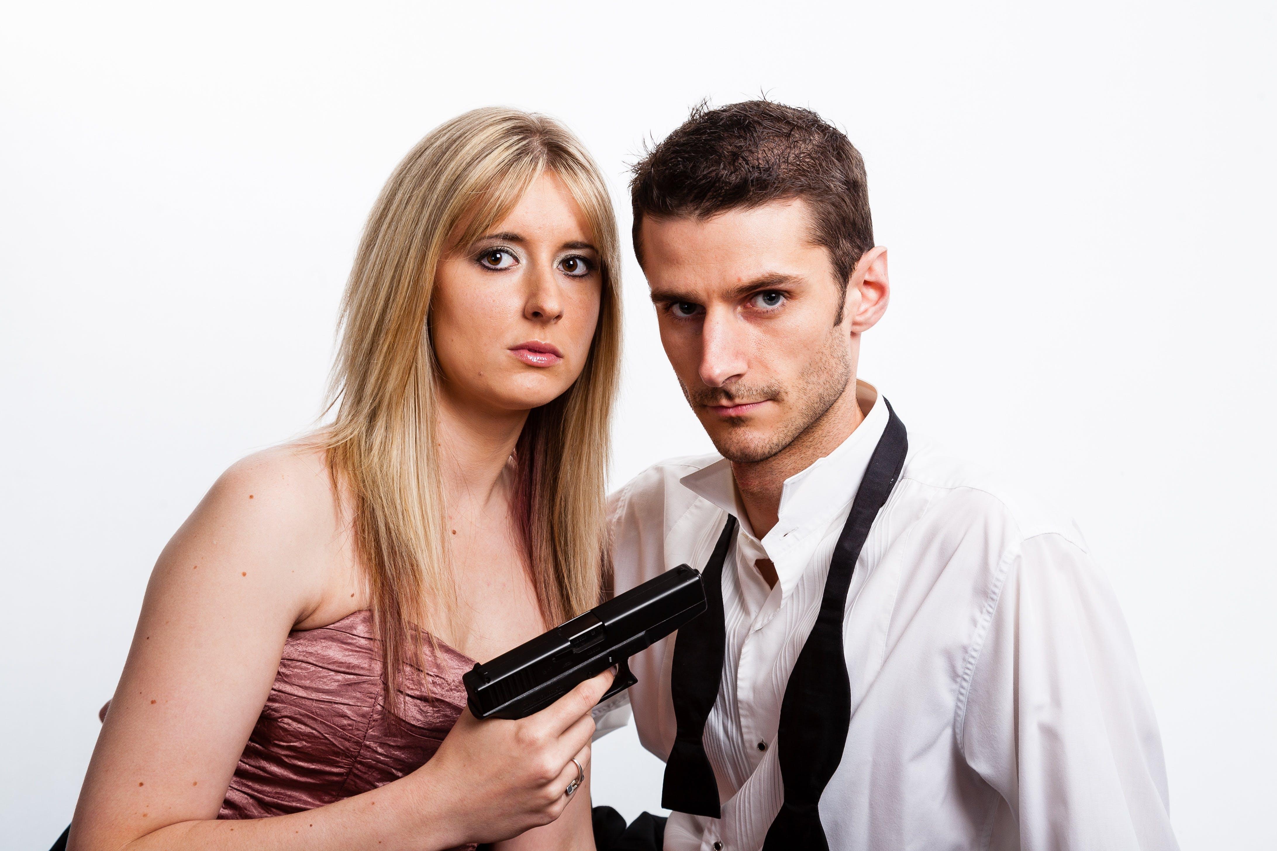 Woman Holding Pistol