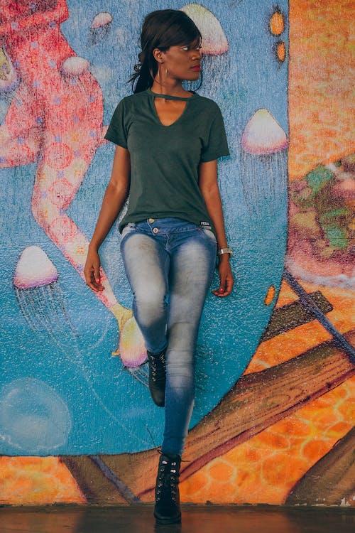 Woman Leaning on Wall Looking Sideways