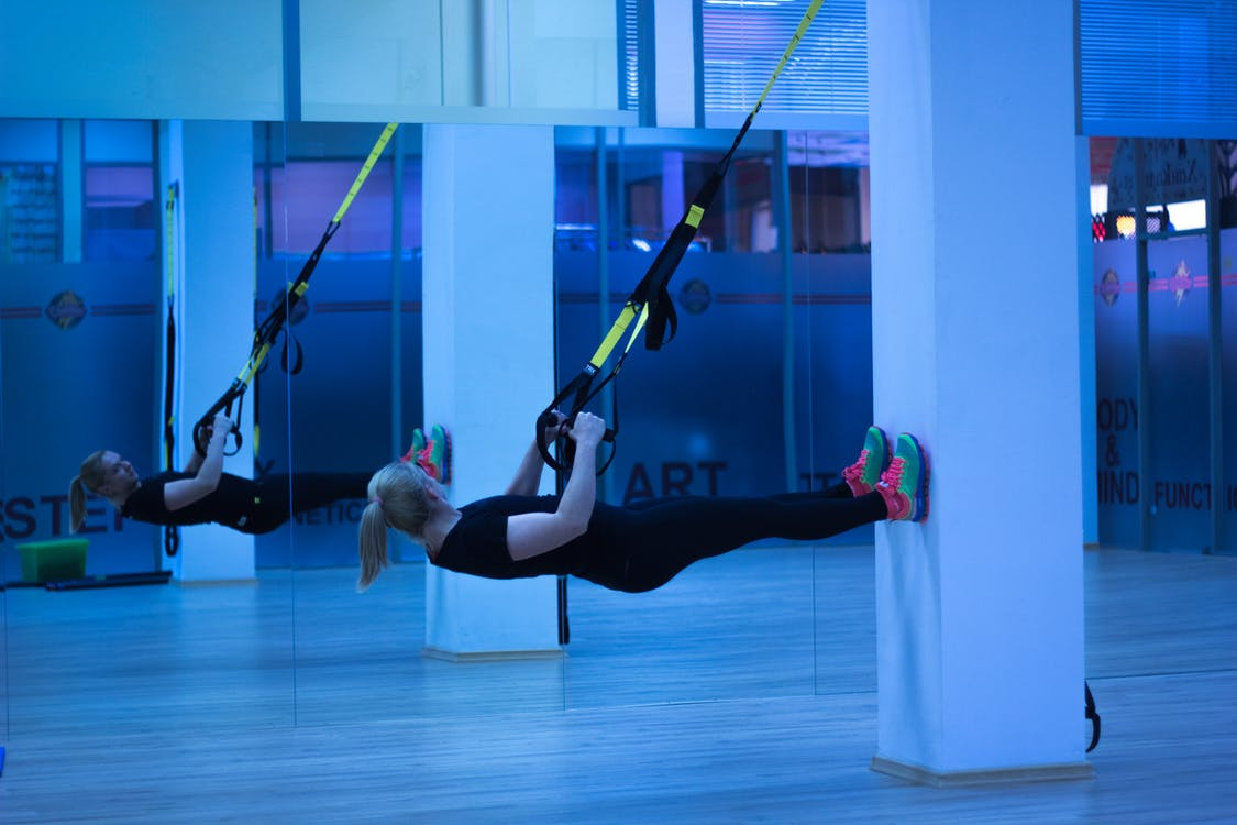 Two Women Exercising Using Resistance Bands