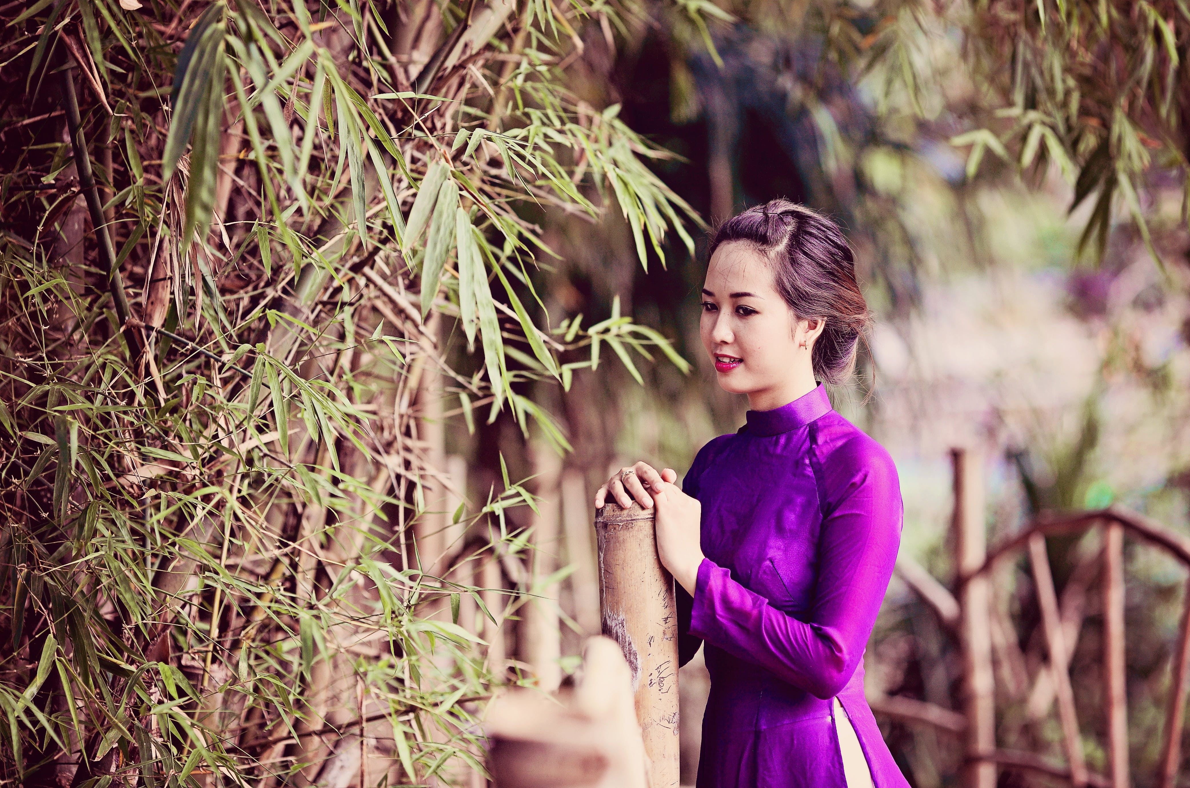 Woman Standing Beside Bamboo Plant
