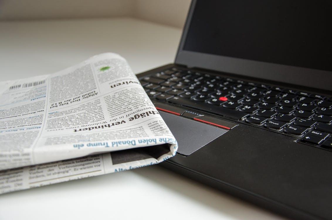 Newspaper on Black Lenovo Thinkpad
