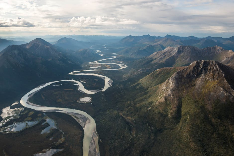 Green mountains and flowing river