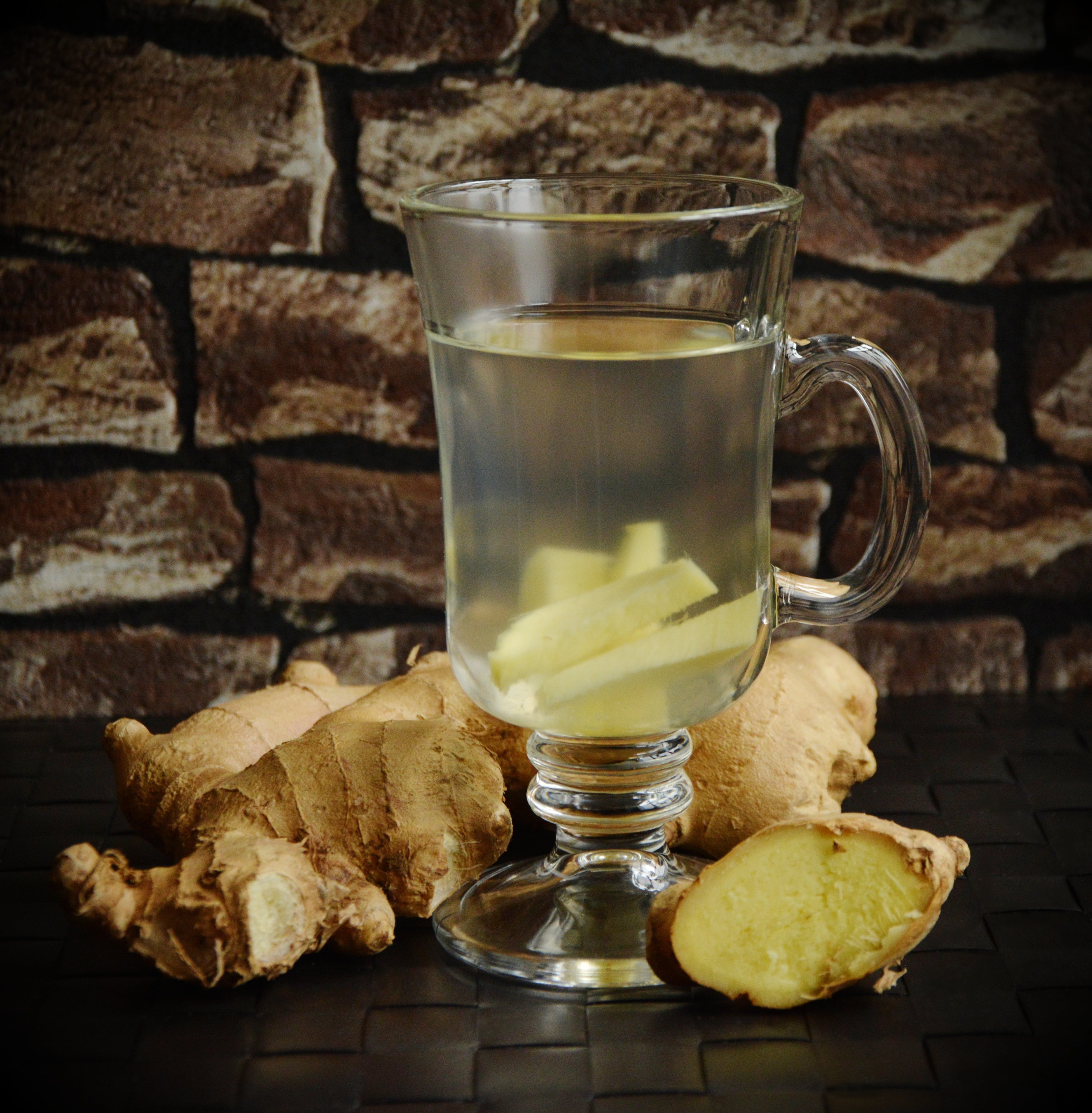 Clear Small-stemmed Glass Surrounded With Gingers