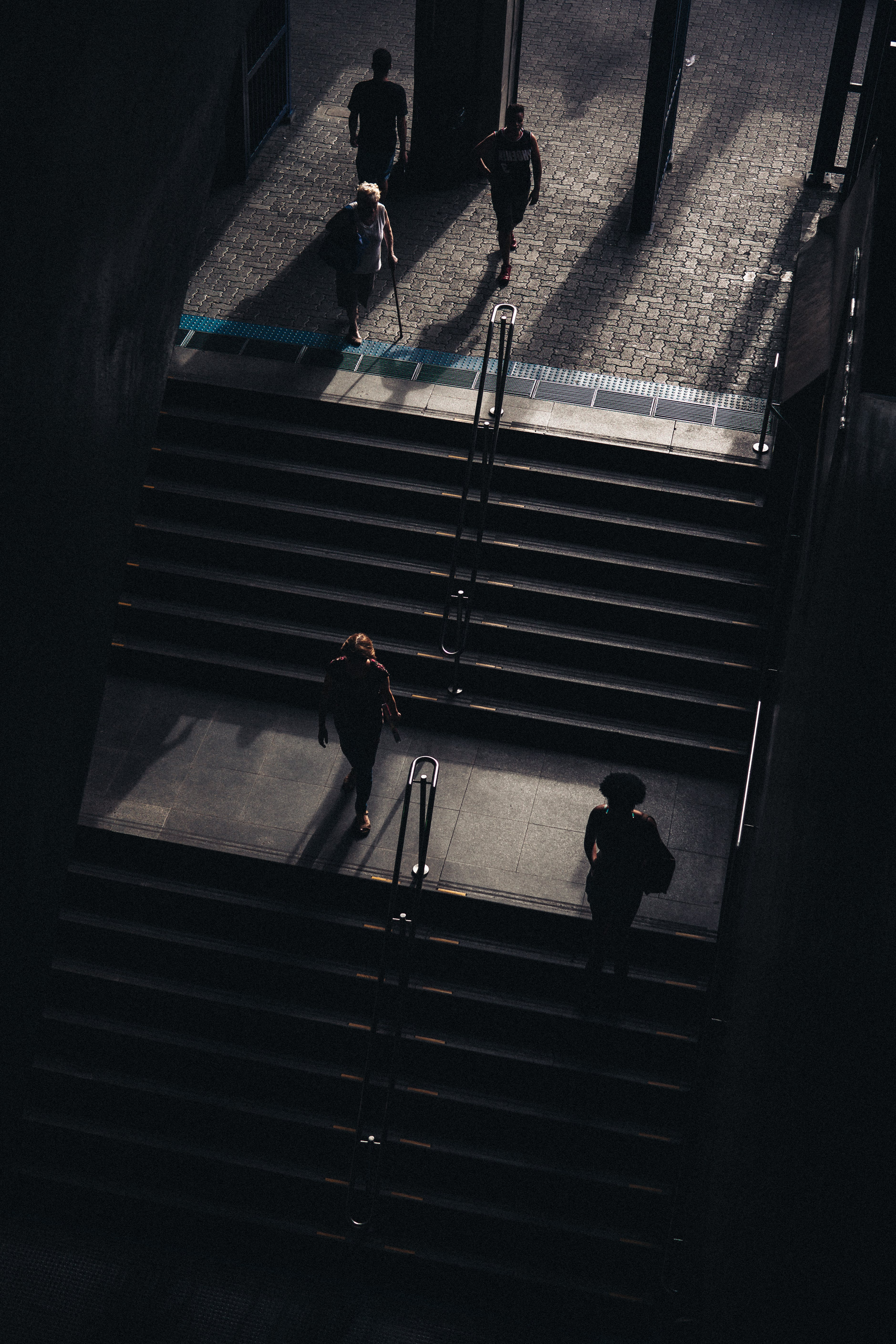 Grayscale Photography of Stairs With People