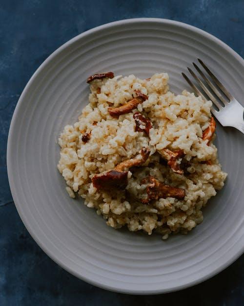 Foto profissional grátis de alimento, almoço, arroz, carne