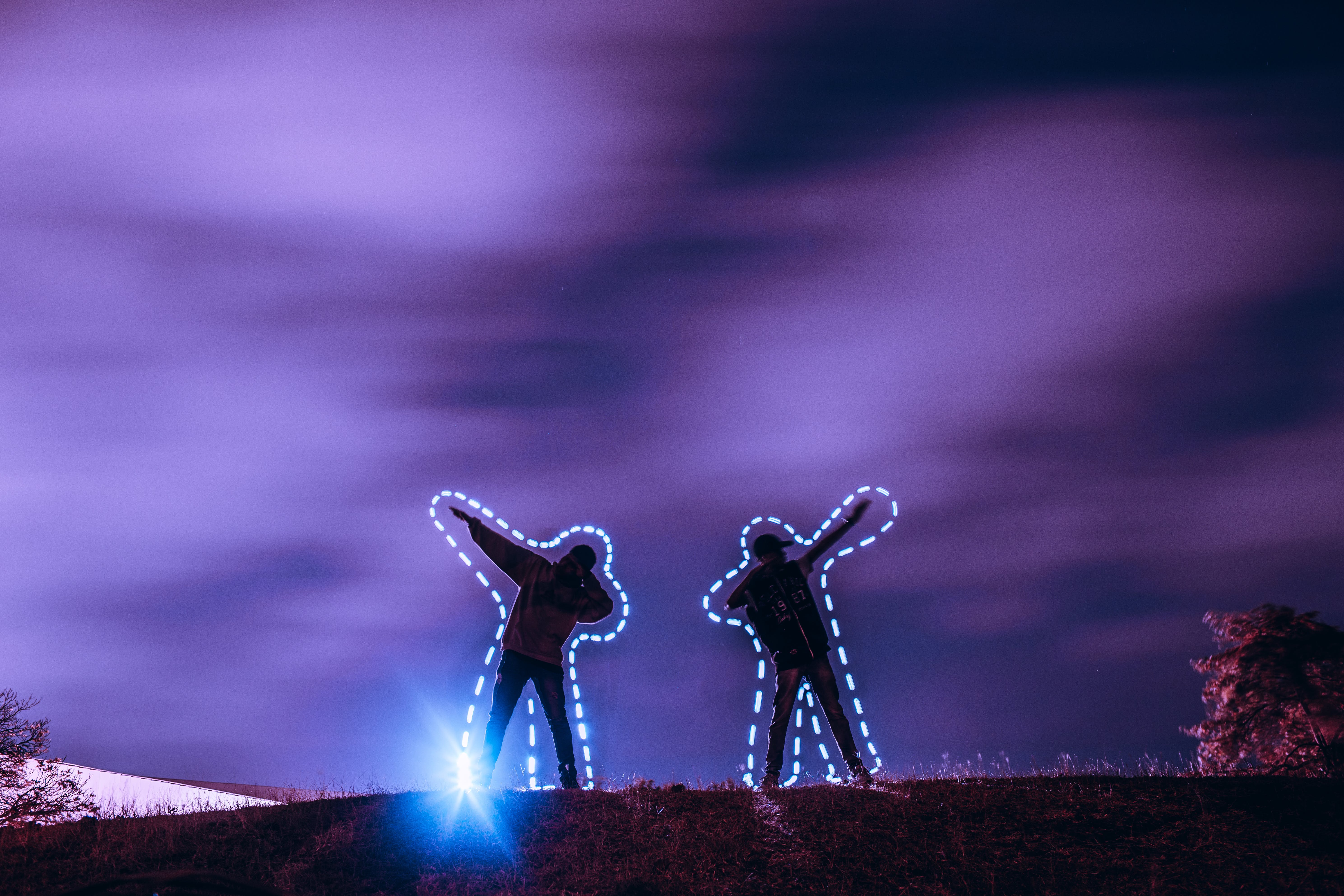 Two People Standing on Hill at Night Time