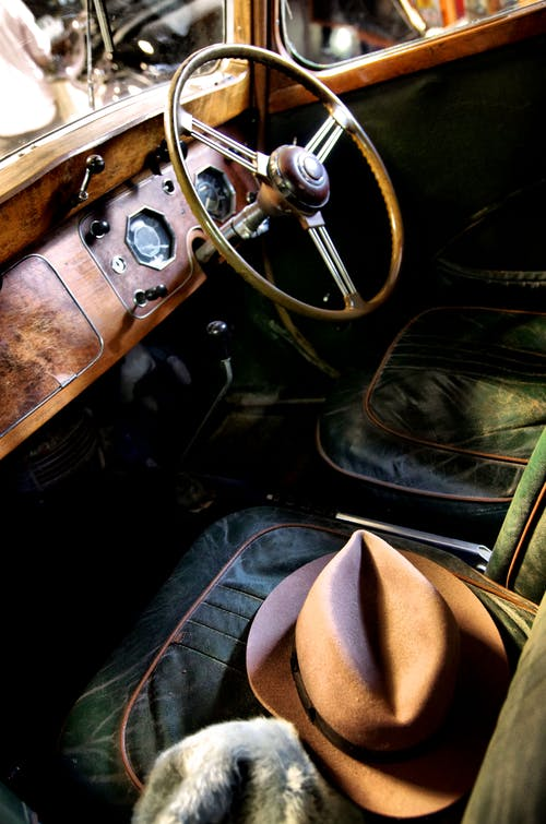 Free stock photo of car, hat, old timer, steering wheel