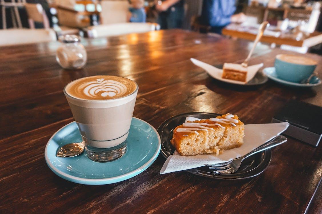Espresso on Teal Saucer Beside Baked Cake