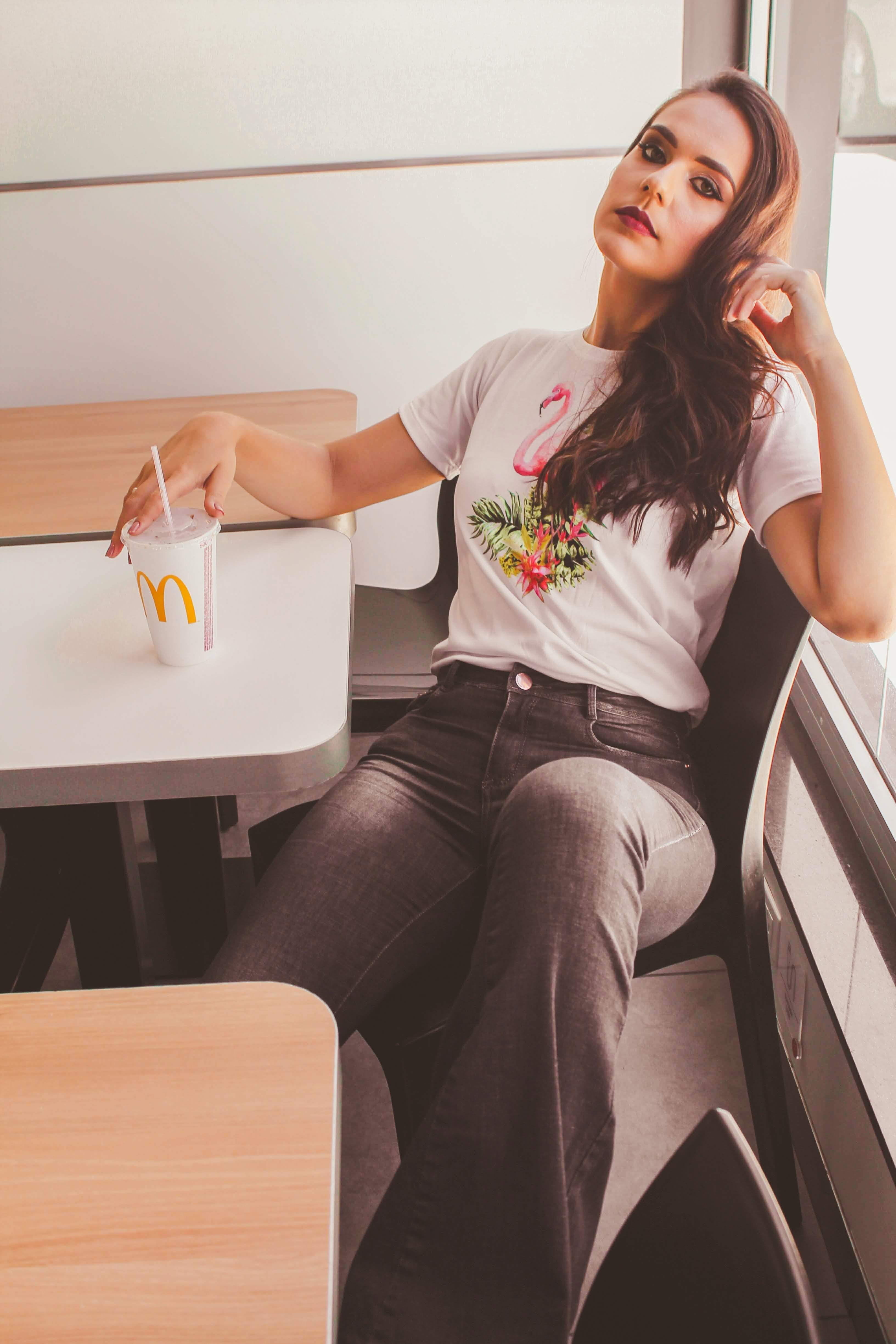 Woman Sitting Down Holding Mcdonald's Cup