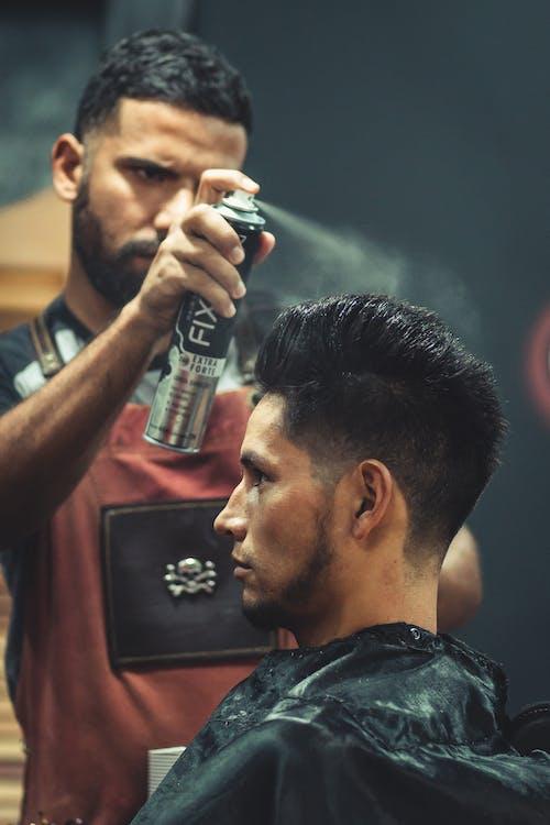Barber Using Hair Spray