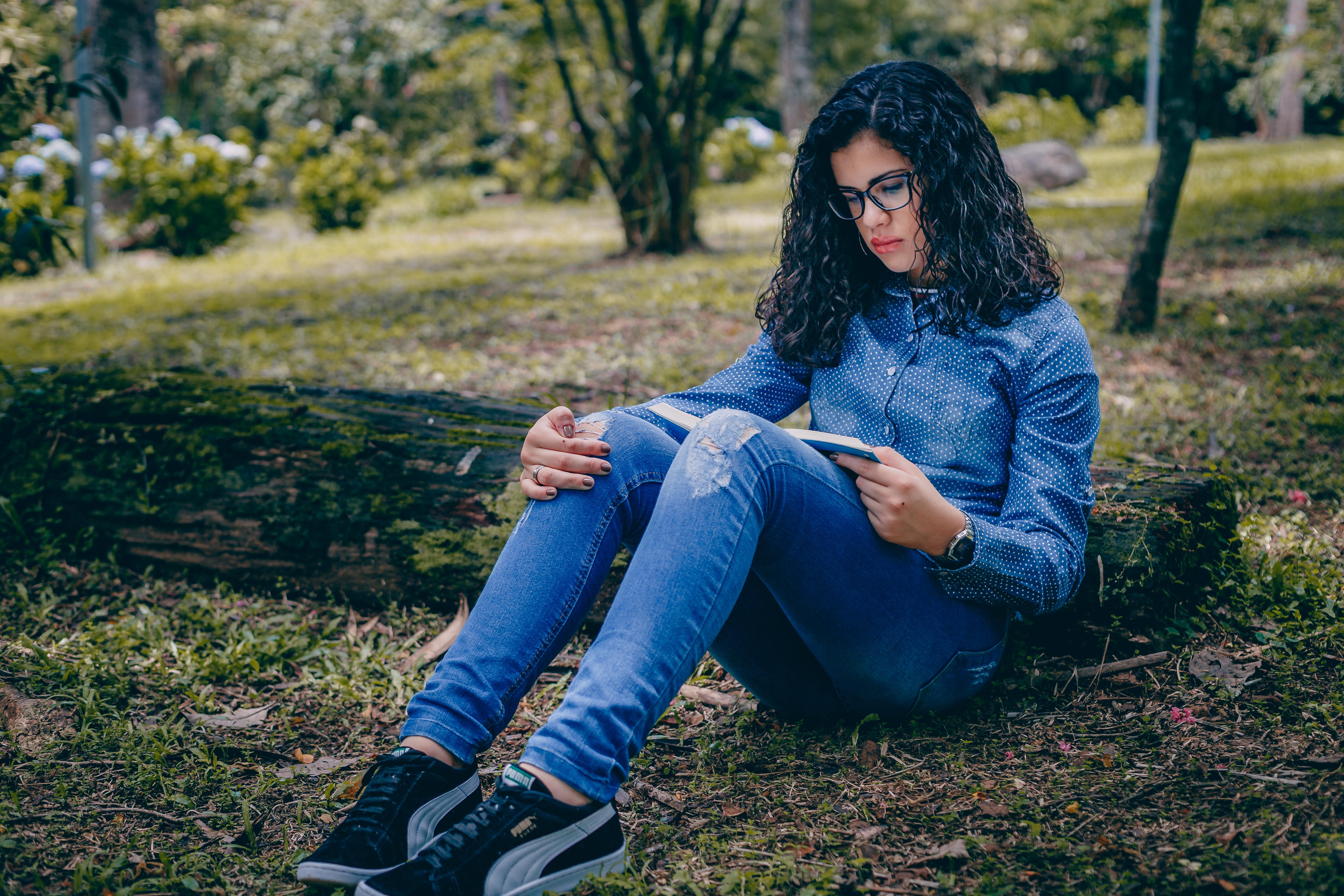 Unknown Celebrity Sitting in Green Grass