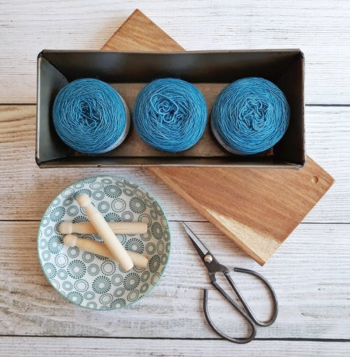 Three Blue Yarn Threads